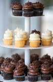 A pyramid of cupcakes on a platter royalty free stock photo