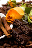 Chocolate and yellow flower Royalty Free Stock Photo
