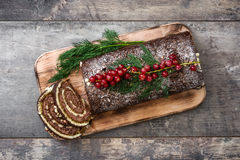 Chocolate yule log christmas cake with red currant Royalty Free Stock Photo