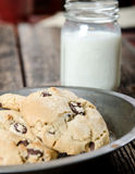 ChocolateChip Cookies and Milk Dessert. ChocolateChip Cookies Dessert with glass of milk in the background Royalty Free Stock Photography