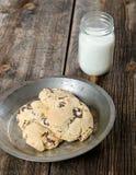 ChocolateChip Cookies and Milk Dessert. ChocolateChip Cookies Dessert with glass of milk in the background Stock Photos
