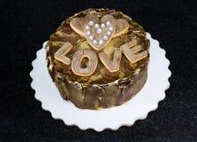 Chocolated позолотило торт с винтажными печеньями пряника Стоковые Фото