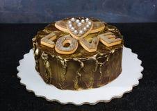 Chocolated позолотило торт с винтажными печеньями пряника Стоковые Фотографии RF