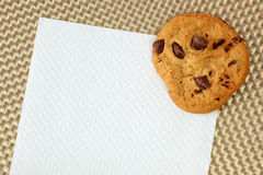 Chocolated chip cookie on a napkin Royalty Free Stock Photo