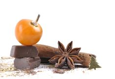 Chocolaten star anise fruit and cinnamon Royalty Free Stock Images