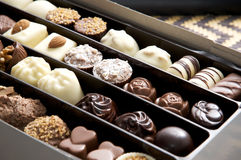 Chocolates. Selection of delicious hand made luxury chocolates in presentation box stock images