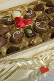 Chocolates. Box of chocolates with red heart Royalty Free Stock Photo