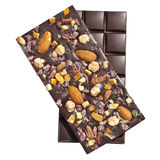 Chocolates. Two dark brown chocolates with various nuts isolated on white studio background Stock Images