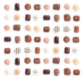 Chocolates. In a uniform pattern isolated on white royalty free stock photos