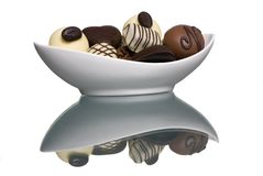 Chocolates 4. A small bowl of chocolates in a bowl with a perfect reflection on the table top Royalty Free Stock Images