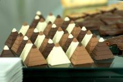 Chocolates. Chocolate pyramids on display at the celebration, selective focus Royalty Free Stock Image
