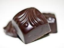 Chocolates. Three chocolates stacked on a WHITE BACKGROUND Stock Photography