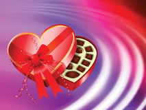 Chocolates on Abstract Liquid Wave Background Stock Image