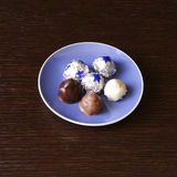 Chocolates. With almond, coconut and hazelnuts Royalty Free Stock Images
