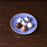 Chocolates. With almond, coconut and hazelnuts in dark, milk, white chocolate Stock Image