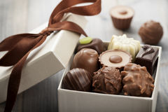 Chocolates. Assorted chocolates confectionery in their gift box stock image