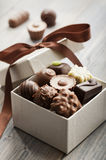 Chocolates. Assorted chocolates confectionery in their gift box royalty free stock images