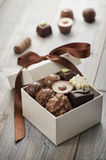 Chocolates. Assorted chocolates confectionery in their gift box stock images