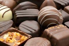 Chocolates. Assortment of fine dark, brown and white chocolates stock image