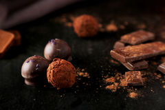 Chocolates on the black background Royalty Free Stock Image