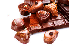Chocolates border isolated on white Stock Images