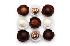 Chocolates in bowl on the white background Stock Photography