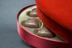 Chocolates in box close-up. Chocolates in red velvet box close-up royalty free stock photos