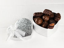 Chocolates in a box in form of heart on a white background. Chocolates in a box in form of heart on a white background Stock Image
