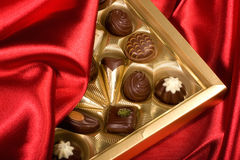 Chocolates box on red satin Stock Images