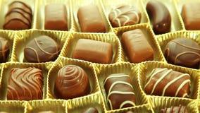 Chocolates box, tasty pralines background stock footage