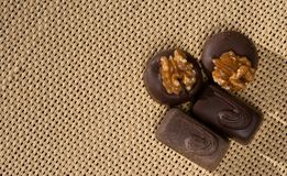 Chocolates on a burlap royalty free stock photos