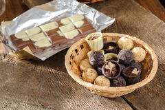 Chocolates and chocolate in a basket Stock Photo