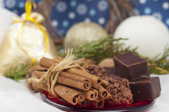 Chocolates, cinnamon and walnut Royalty Free Stock Photos