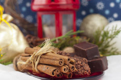 Chocolates, cinnamon and walnuts Stock Photography