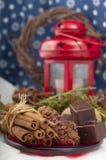 Chocolates, cinnamon and walnuts Stock Photography
