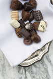 Chocolates on cloth napkin in bowl Royalty Free Stock Image