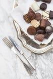Chocolates on cloth napkin, fork and knife Stock Photography