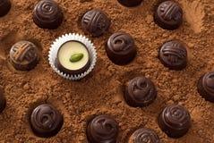 Chocolates on cocoa a powder Royalty Free Stock Photography