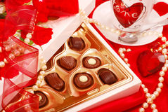 Chocolates and coffee for Valentine. Box of  chocolates and cup of coffee for Valentine`s day Royalty Free Stock Photos