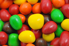 Chocolates coloridos Imagens de Stock
