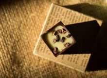 Chocolate cube. The chocolates cube with milk, raisins and nuts stuffed. Chocolate is yummy Royalty Free Stock Photos