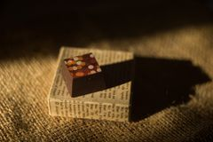 Chocolate cube. The chocolates cube with milk, raisins and nuts stuffed. Chocolate is yummy Royalty Free Stock Image