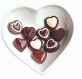 Chocolates del corazón de la tarjeta del día de San Valentín Fotos de archivo libres de regalías