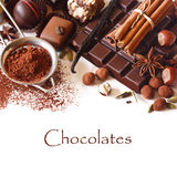 Chocolates. Delicious chocolates and spices on a white background stock images