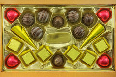 Chocolates of different types lie in the open box. In the open box are different candy of dark chocolate Royalty Free Stock Photography