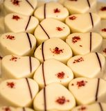 Selection of romantic white chocolate hearts royalty free stock photo