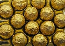 Chocolates dourados Imagens de Stock