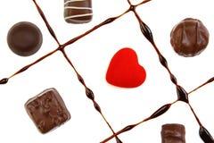 Chocolates e coração vermelho Foto de Stock