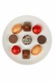 Chocolates em uma placa branca Imagens de Stock Royalty Free