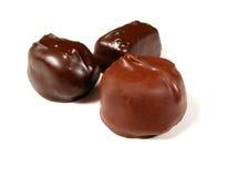 Chocolates en el blanco 2 fotografía de archivo